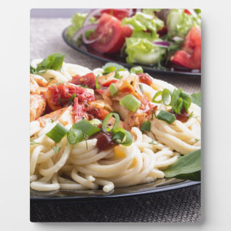 Home-cooked meals on a gray mat - spaghetti plaque