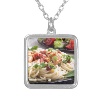 Home-cooked meals on a gray mat - spaghetti silver plated necklace
