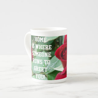 Home is where someone runs to greet you tea cup