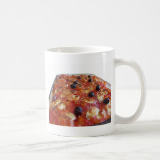Home made baked pasta on white background coffee mug