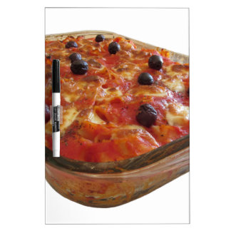 Home made baked pasta on white background dry erase board