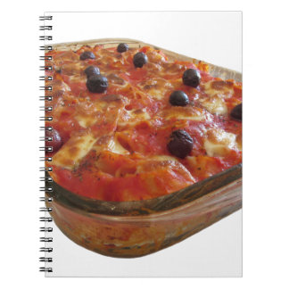 Home made baked pasta on white background spiral note books