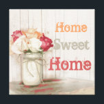 """Home Sweet Home Country Mason Jar Wrapped Canvas<br><div class=""""desc"""">Home Sweet Home Country Mason Jar with Twine Bow and Roses Wrapped Canvas. This is a perfect country decor wall art piece. It has a lot of vintage country charm with the canning jar, rose, and twine bow. The colors are peach coral, cream, and salmon pink. The background is a...</div>"""