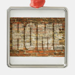 Home written in ancient brick square metal christmas ornament