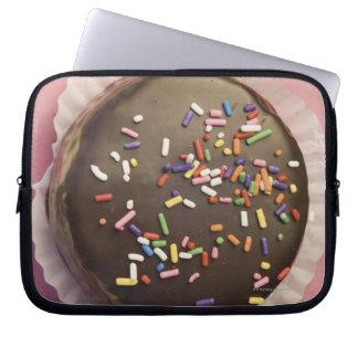 Homemade chocolate dessert with sprinkles laptop sleeve