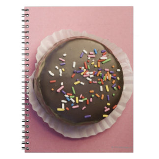 Homemade chocolate dessert with sprinkles spiral note books