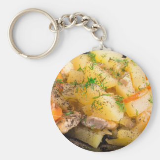 Homemade dish of slices of stewed potatoes keychain