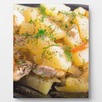 Homemade dish of slices of stewed potatoes plaque