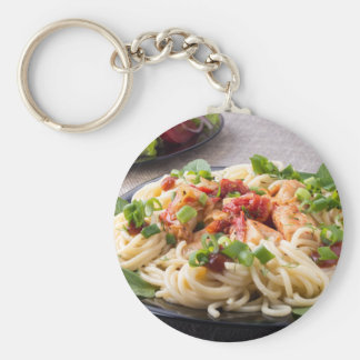 Homemade pasta with stewed chicken and vegetable keychain
