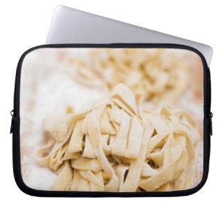 Homemade ribbon pasta, close up laptop sleeve