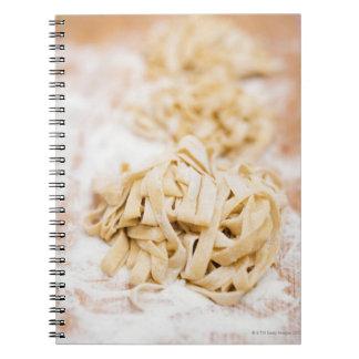Homemade ribbon pasta, close up notebook