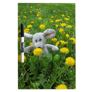 Homemade soft toy on the lawn dry erase board