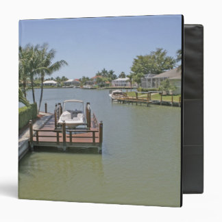 Homes and docks on canal Marco Island Florida Binder