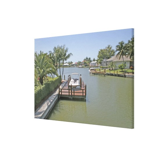 Homes and docks on canal Marco Island Florida Canvas Print