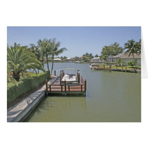 Homes and docks on canal Marco Island Florida Greeting Card