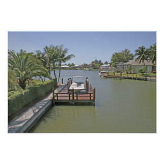 Homes and docks on canal Marco Island Florida Poster