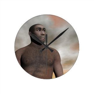 Homo erectus masculino reloj redondo mediano