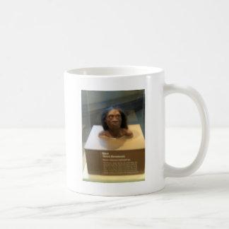 Homo floresiensis; museum exhibit coffee mug