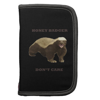 Honey Badger Don't Care On Black Background. Funny Folio Planners