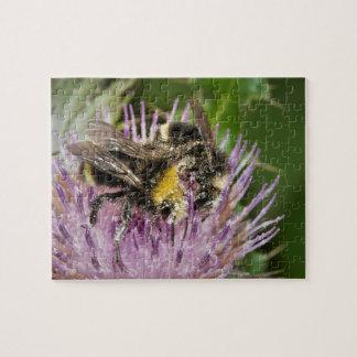 Honey bee gathering pollen on spiky purple thistle jigsaw puzzle