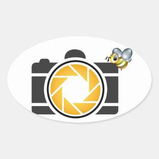 Honeybee on a Digital camera Oval Sticker