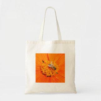 honeybee pollinating flower tote bag