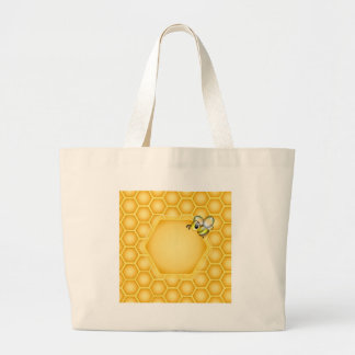 Honeycomb background with a cute honeybee large tote bag