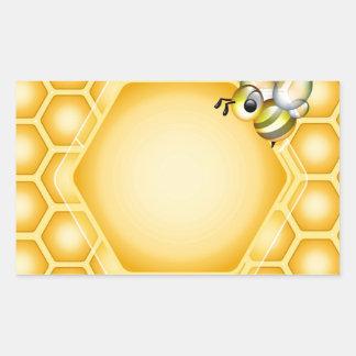 Honeycomb background with a cute honeybee rectangular sticker