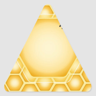 Honeycomb background with a cute honeybee triangle sticker