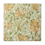 """Honeysuckle by William Morris Ceramic Tile<br><div class=""""desc"""">A wallpaper design by William Morris from 1895 of a honeysuckle vine with orange flowers and sage green leaves.</div>"""