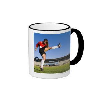 Hooligan kicking mug