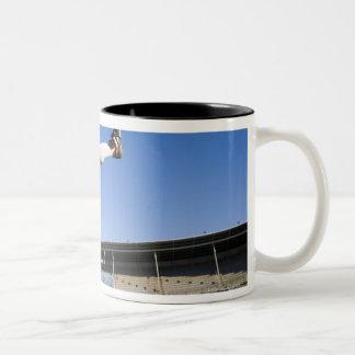 Hooligan kicking coffee mugs