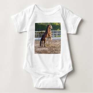 Horese in a playful mood baby bodysuit