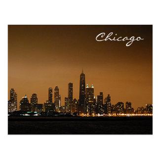 Horizonte de Chicago en la noche Postal