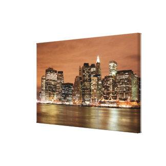 Horizonte de New York City en las luces de la Impresión En Lona