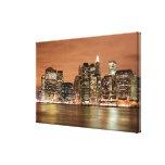 Horizonte de New York City en las luces de la noch Impresiones En Lona