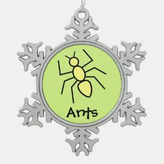 Hormiga amarilla linda del vector (fondo del verde adorno de peltre en forma de copo de nieve