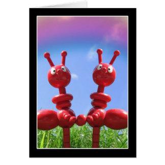 Hormigas en la hierba tarjetón
