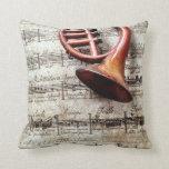 horn ornament on music throw pillow
