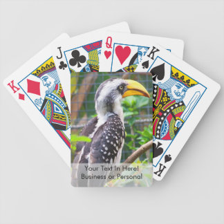 hornbill on perch in green plants bicycle playing cards