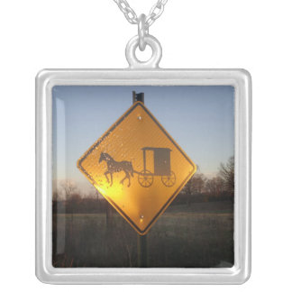 Horse and Buggy sign on necklace