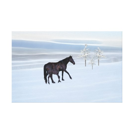 Horse and foal in snow canvas print