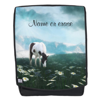 Horse grazing  in field with daisies backpack