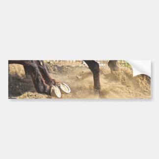 Horse hooves trampling the dirt. bumper sticker