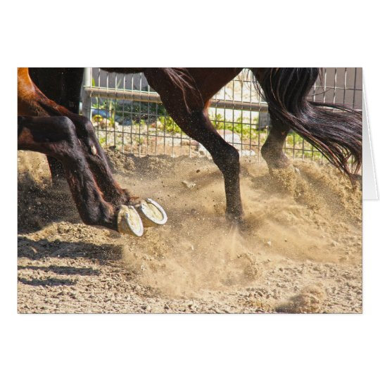 Horse hooves trampling the dirt. card