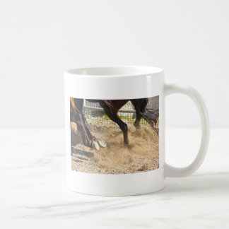 Horse hooves trampling the dirt. coffee mugs
