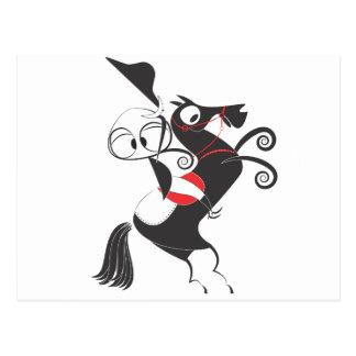 Horse rider performing pirouette rearing up postcard