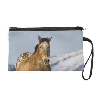 Horse Running in Snow 2 Wristlet Purse