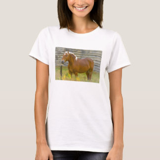 Horse standing by a fence and barn T-Shirt