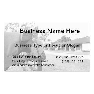 horse staring at barn bw business card